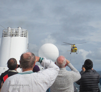 Helicopter disembarking pilot from ship