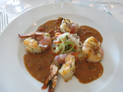 Pancetta-Wrapped Jumbo Shrimp with Kalamata Olive Sauce and Vegetable Julienne