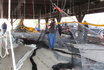 Fishermen fixing their nets